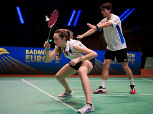 Man and woman playing badminton