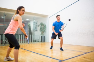 Couple playing squash